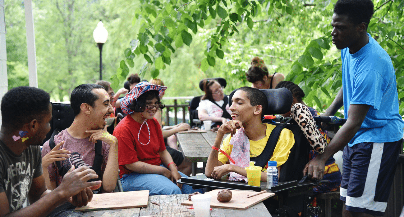 A group of people of all abilities enjoy each other's company at Camp Loyaltown